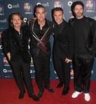 """""""Take That"""" & Robbie Williams (antras iš kairės)"""